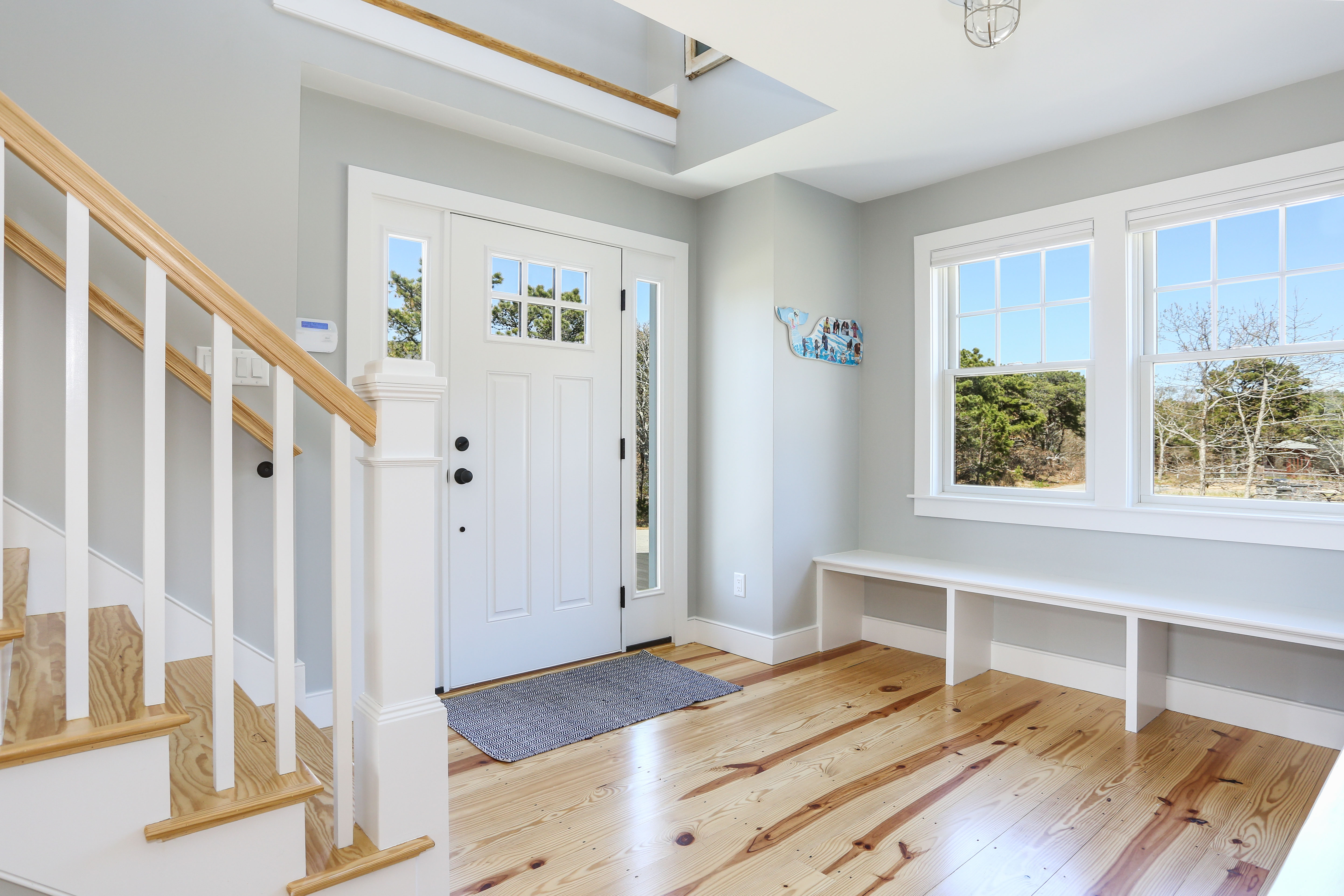 Entry foyer with bench cape cod by REEF