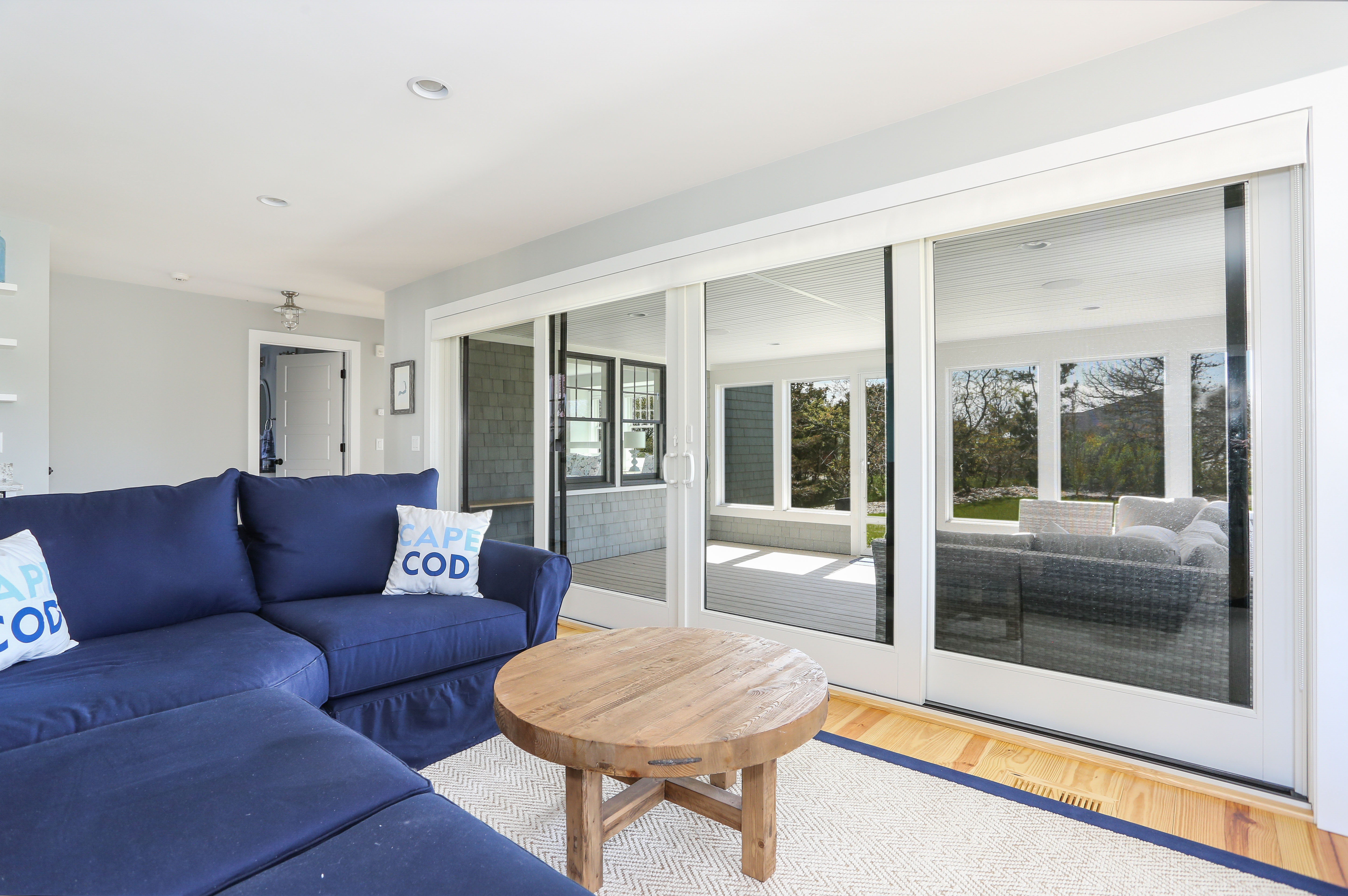 Screened porch in beach house by REEF